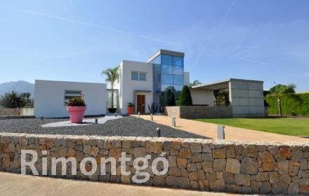 Stunning modern design villa located in the prestigious residential complex of Tosalet in Dénia, Alicante.