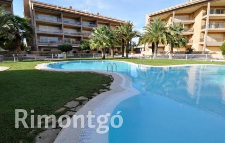 Apartment with a communal pool within metres of the beachfront in Javea.