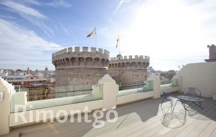 Modern penthouse apartment with direct views of Torres de Quart.